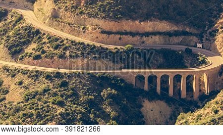 View From Granatilla Carboneras Viewpoint Of Hilly Landscape, Curved Road And Large Viaduct. Cabo De