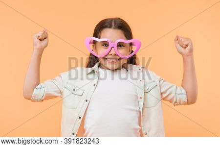 Kid Girl Heart Shaped Eyeglasses Look Cheerful. Girl Wear Cute Eyeglasses Cheerful Face. Child Happy
