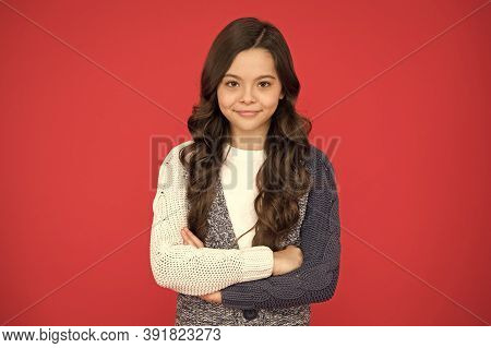 Fashion Every Day. Fashion Look Of Little Model. Happy Child Keep Arms Crossed Red Background. Small