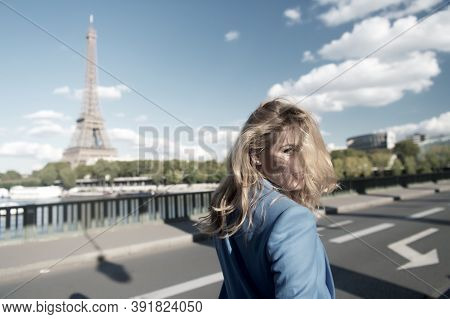 Girl Traveler With Blond Hair At Eiffel Tower In Paris, France On Sunny Summer Day Outdoor. Architec