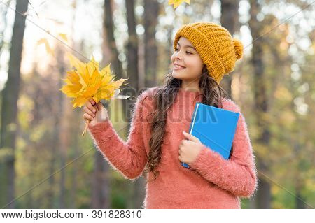 Awesome Autumn Activities For School. Happy Kid Hold Book And Autumn Leaves Outdoors. Back To School