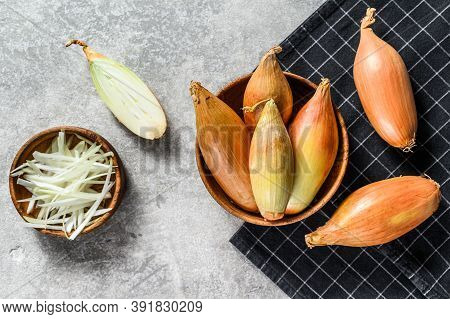 Yellow Raw Shallot Onions, Sliced And Halved. Gray Background. Top View. Space For Text