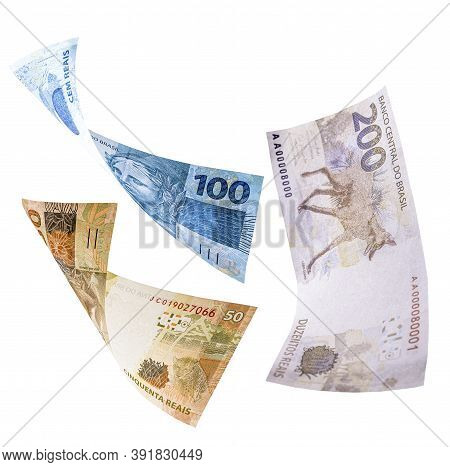 Two Hundred, One Hundred And Fifty Reais Notes In Fall, Isolated White Background. Concept Of Big Lo