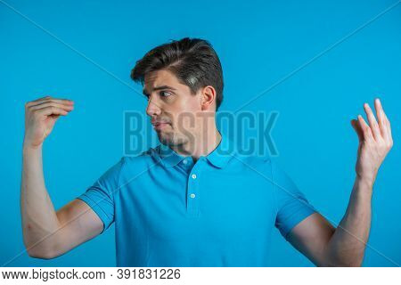 Handsome Bored Man Showing Bla-bla-bla Gesture With Hands And Rolling Eyes Isolated On Blue Backgrou