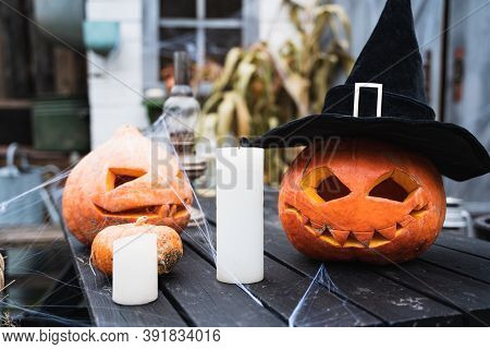 Orange Pumpkin For Halloween In Black Witch, Wizard Hat, Jack-o-lantern With Scary Carved Eyes, Mout