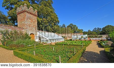 Oxborough, Norfolk, England - September 19, 2020: Greenhouse  Vegetable Garden And Tower At Oxburgh