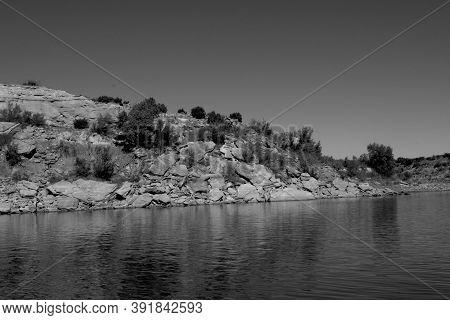 Cliffs And Rough Rock Strewn Shoreline Of Lake Mckinsey Near Amarillo In The Texas Panhandle.