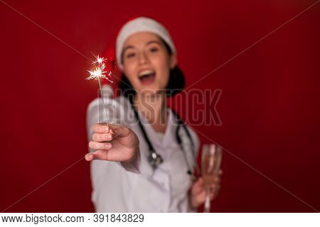 Burning Sparklers In Hand Of Attractive Sexy Female Doctor Selebrating Christmas And New Year With G