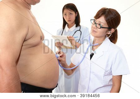 Physician with an examination of obese patient