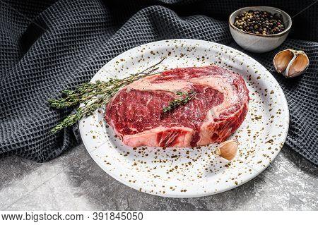 Marbled Beef Fillet Steak. Raw Rib Eye, Ribeye. Gray Background. Top View
