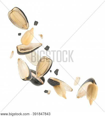 Sunflower Seeds With Hull Flying On White Background