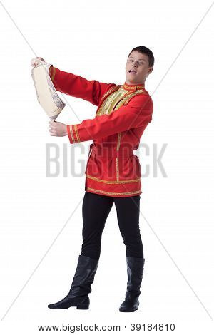 Dancer in russian costume with paper