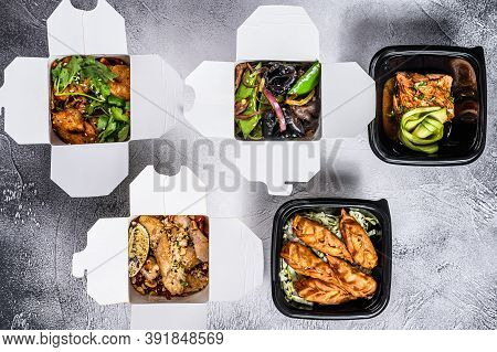 Spring Rolls, Dumplings, Gyoza And Wok Noodles In Take Away Box. Healthy Lunch. Take And Go Organic