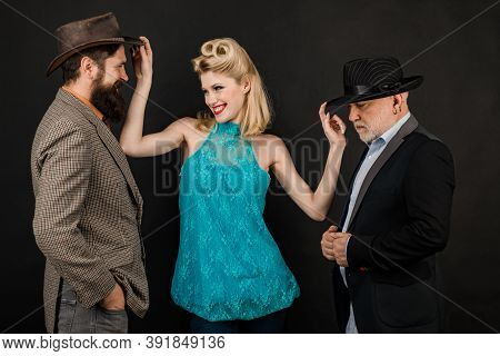 Mature Stylish Senior Man And Berded Guy With Funny Yong Woman Wear Retro Hat, Modern And Hipster Or