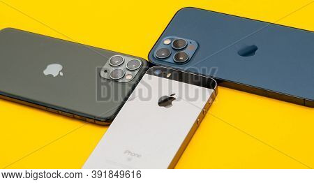Paris, France - Oct 23, 2020: Close-up View Of Se, 11 Pro And New Iphone 12 Pro Max 5g Smartphone Mo