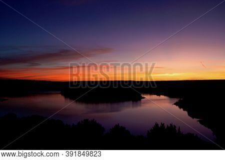 Sunrise At Lake Mckinsey Near Amarillo In The Texas Panhandle.