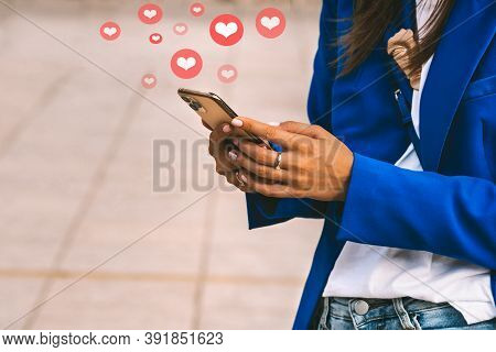 Woman Hands Holding Smartphone. Social Media Illustration. Social Media Interactions On Mobile Phone