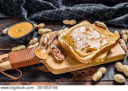 Crispy Toast With Peanut Butter On Breakfast. Dark Wooden Background. Top View