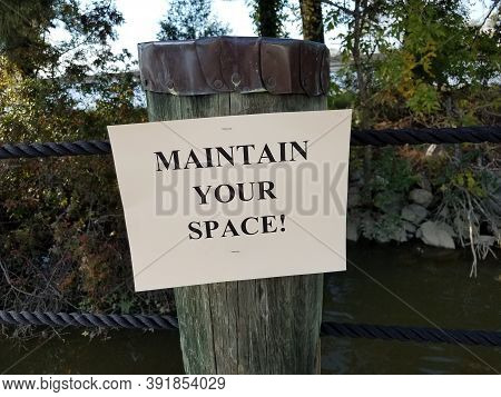 Maintain Your Space Sign On Wood Post