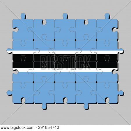 Jigsaw Puzzle Of Botswana Flag In Black Stripe With A Thin White Frame On Light Blue. Concept Of Ful
