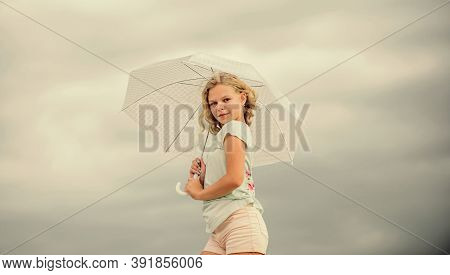 Happy Childrens Day. Enjoying Ease. Carefree Child Outdoors. Girl With Umbrella Cloudy Sky Backgroun