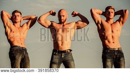Showing Abs And Biceps. Full Of Energy. Inspiring Better Health. Three Muscular Men Sky. Athletic Bo