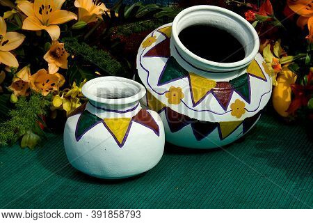 Painted Pots Placed On Green Mat With Flowers And Foliage Behind At Republic Day Horticultural Show