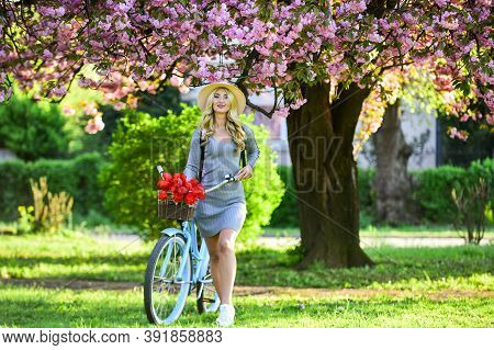 Eco Transportation. Excursion To Garden. Athletic Woman Ride Retro Bicycle. Travel By Bike. Spring H