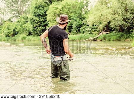 Catch A Trophy Fishing. Fisherman With Fishing Rod. Summer Weekend. Big Game Fishing. Mature Man Fly