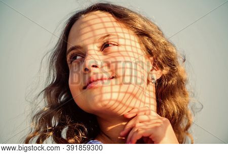Child Pleased With Warm Sunlight Looks Relaxed Blue Sky Background. Take Care Skin Put Sunscreen Cos
