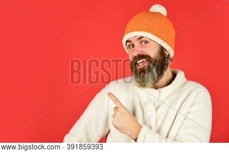 Winter Clothes And Accessories. Handsome Man Knitted Hat With Pom Pom. Fashion Concept. Feeling Good
