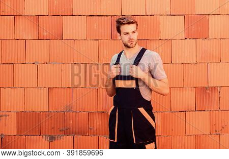 Inspect Diagnose Problems Figure Out Way Correct. Worker Brick Wall Background. Building Constructio