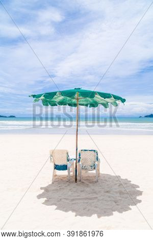 Chairs And Umbrella On The Beach - Tropical Holiday.