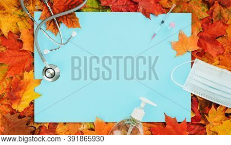 Flu And Cold Season Frame On Blue With Fall Leaves. Flu Season Or Second Wave. Face Protective Mask,