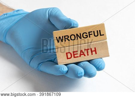 Wrongful Death Concept Inscription In Doctor Hand Isolated On White Background, Medical Working At O