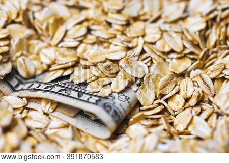 Dollar Money In Oat Flakes. Oat Export Prices, Economic Concept. Decrease Or Increase In Price Of Ro