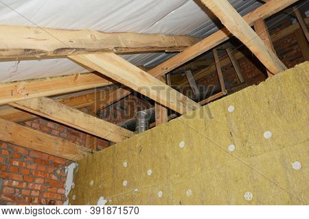 A View From Inside A House Attic Construction On Unfinished Roof With Wooden Frame, Roof Beams, Raft