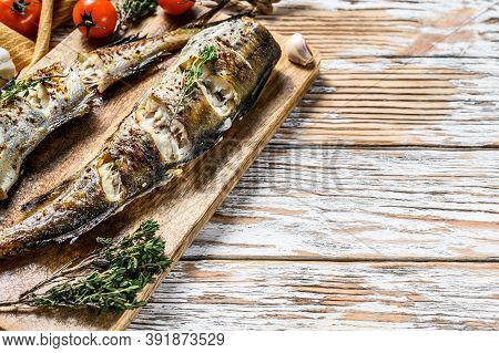 Delicious Grilled Pollock With Fresh Thyme And Tomatoes. White Background. Top View. Copy Space