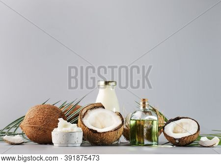 Mct Coconut Butter Or Coconut Oil. Organic Healthy Food, Beauty And Spa Concept. Gray Background. Co
