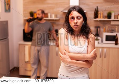 Abused Woman Being Depressive And Trembled Because Of Husband Agression. Violent Aggressive Man Sing