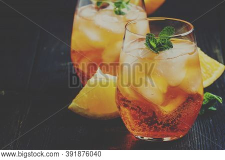 Italian Cocktail With Aperitif, Ice And Orange, Selective Focus And Toned Image
