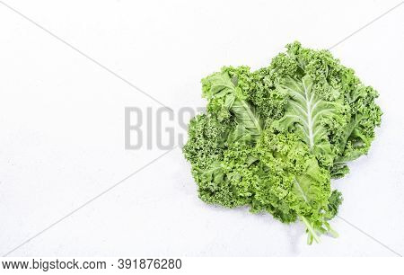 Kale Cabbage. Green Vegetable Leaves, Top View On White Background, Healthy Eating, Vegetarian Food