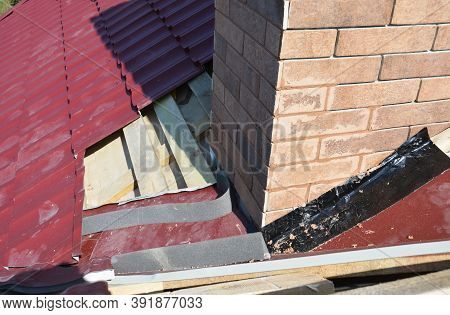 A Close-up On A Roofing Construction, Installation Of Metal Roof Tiles On Wood Roof Sheathing Around