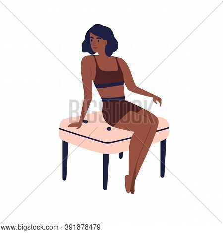 Young Dark Skin African American Woman In Sport Underwear Sitting On Chair. Stylish Slim Girl Model