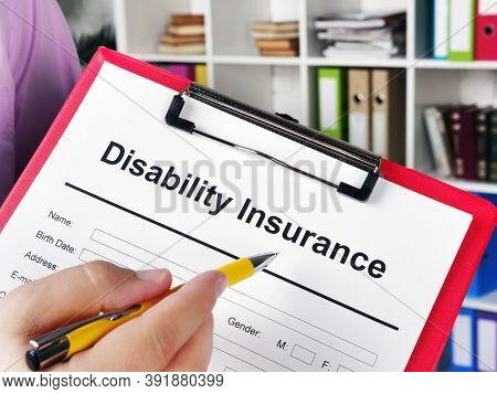Insurer Shows Disability Insurance Application For Signing.