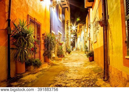 Narrow Ancient Streets During The Evening In The Little Medieval Town Bosa, Sardinia Island, Italy