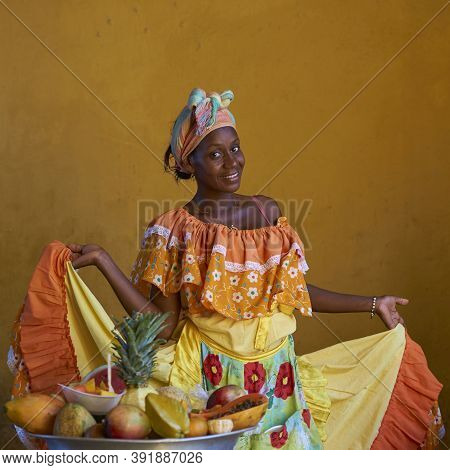 Cartagena De Indias, Colombia - January 24, 2017: Woman In Traditional Costume Posing For A Photogra