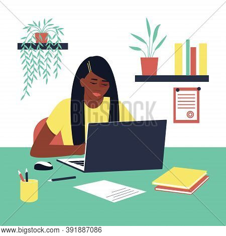 Student Girl African American Doing Homework. A Laptop And Book Are On The Table. Concept For Learni