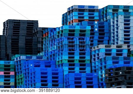 Pile Of Plastic Shipping Pallet Isolated On White. Industrial Plastic Pallet Stacked At Factory. Car
