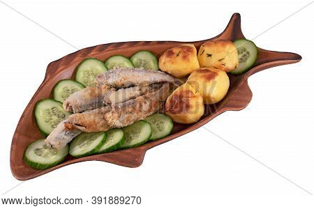 Fried Smelt With Cucumbers And Potatoes In A Fish Form Plate Isolated On A White Background